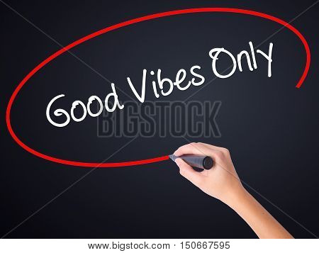 Woman Hand Writing Good Vibes Only  With A Marker Over Transparent Board