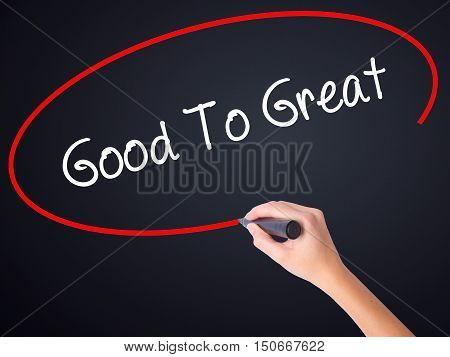 Woman Hand Writing Good To Great With A Marker Over Transparent Board