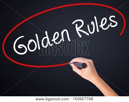 Woman Hand Writing Golden Rules With A Marker Over Transparent Board