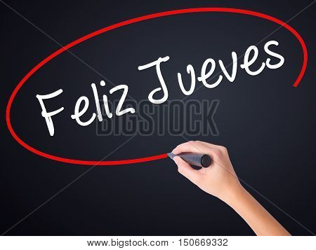 Woman Hand Writing Feliz Jueves (happy Thursday In Spanish) With A Marker Over Transparent Board .
