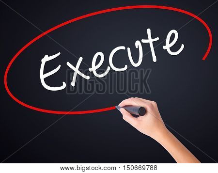Woman Hand Writing Execute With A Marker Over Transparent Board