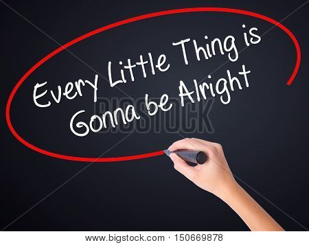 Woman Hand Writing Every Little Thing Is Gonna Be Alright With A Marker Over Transparent Board