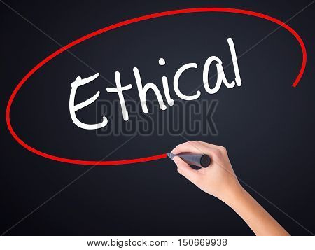 Woman Hand Writing Ethical  With A Marker Over Transparent Board