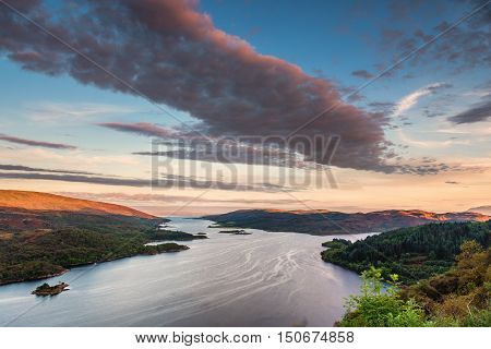 Kyles of Bute at Sunset, also known as Argyll's Secret Coast in the Firth of Clyde, looking down the eastern Kyle with warm sunlit hilltops