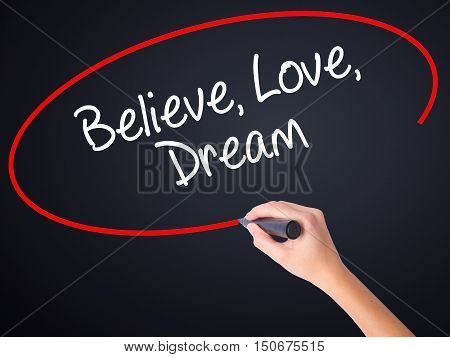 Woman Hand Writing Believe Love Dream With A Marker Over Transparent Board