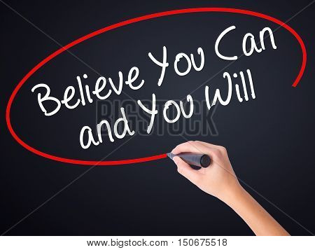 Woman Hand Writing Believe You Can And You Will With A Marker Over Transparent Board