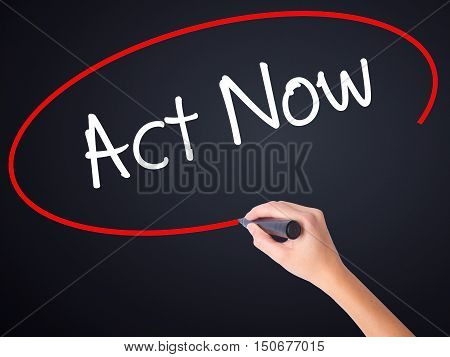 Woman Hand Writing Act Now With A Marker Over Transparent Board