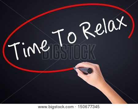 Woman Hand Writing Time To Relax With A Marker Over Transparent Board