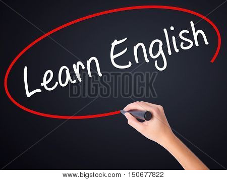 Woman Hand Writing Learn English With A Marker Over Transparent Board