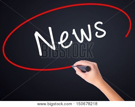 Woman Hand Writing News With A Marker Over Transparent Board
