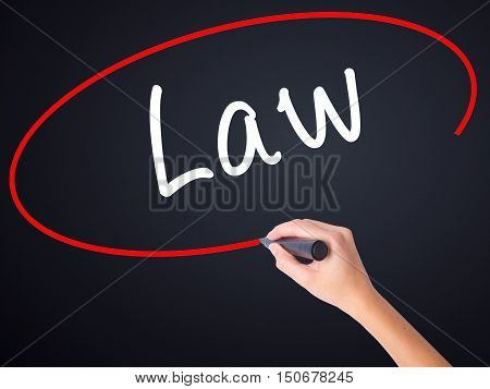 Woman Hand Writing Law With A Marker Over Transparent Board