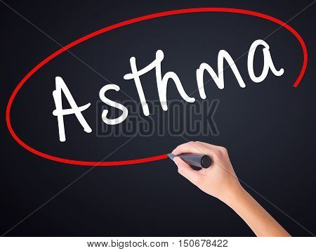 Woman Hand Writing Asthma With A Marker Over Transparent Board