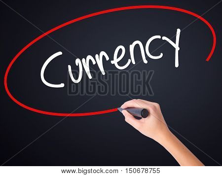 Woman Hand Writing Currency With A Marker Over Transparent Board