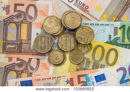 euro bills and  euro coin as background