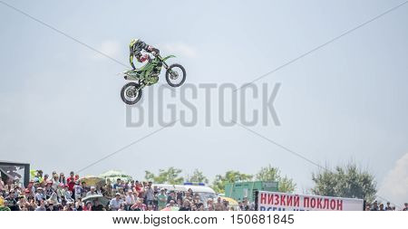 Rostov-on-Don Russia- June 052016: The athlete performs a jump on a motorcycle in the competition of tractors called