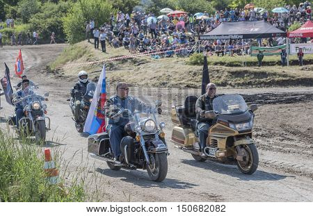 Rostov-on-Don Russia- June 05 2016: Competition for agricultural tractors on the green meadow Bizon Track Show. Bikers open competition