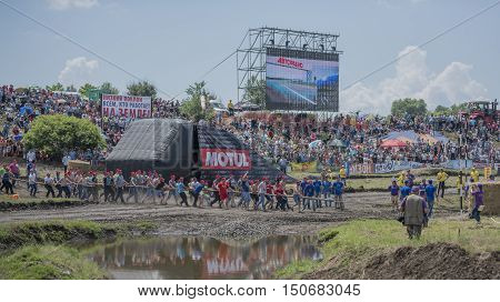 Rostov-on-Don Russia- June 052016: Tug of war with the people of the tractor on Bizon Track Show.Spectators watch the tug