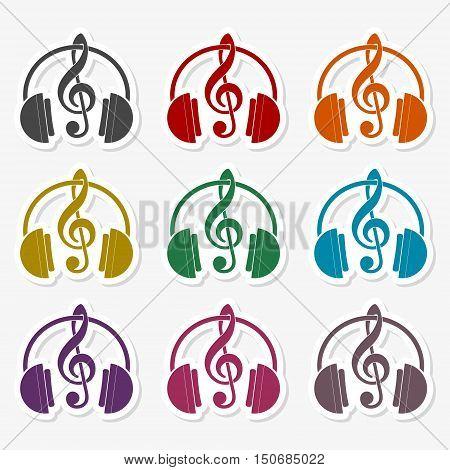Headphones with treble clef sticker set on gray background