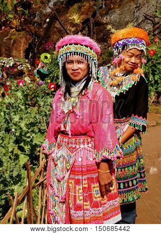 Doi Pui Thailand - December 24 2006: Two Thai women wearing vintage hilltop tribal village clothing with ornate headdresses