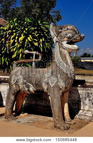 Lampang Thailand - December 28 2012: Mythical stone beast sculpture flanks the entrance stairway at Wat Phra That Lampang Luan *