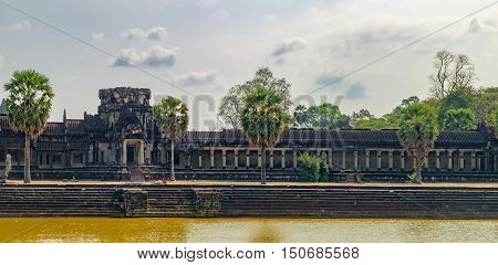 Ruins of Angkor Wat temple in the ancient city of Angkor Siem Reap Cambodia. View from main entrance.