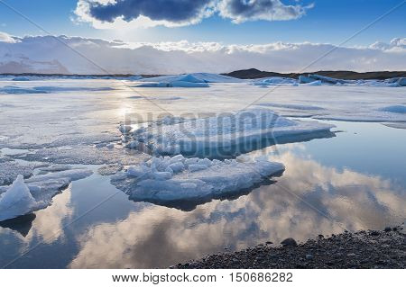 Beautiful winter natural lagoon with sky reflection, natural landscape background