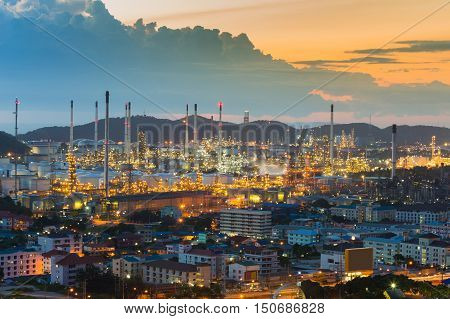 Aerial view Oil refinery with sunset sky and mountain background