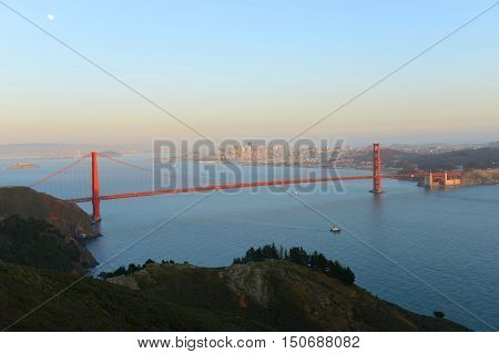 Golden Gate Bridge in dusk, with San Fransisco City at the back ground, San Francisco, California, USA.