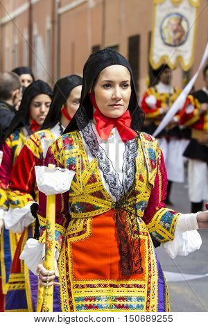 CAGLIARI, ITALY - May 1, 2014: 358 ^ Religious Procession of Sant'Efisio - Sardinia - portrait of a beautiful woman in traditional Sardinian costume