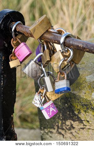 Lovers' padlocks on a railing at whitby Yorkshire