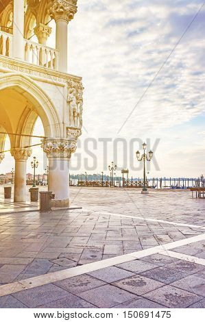 Corner of the Doge's Palace in empty St. Mark's Square lighted by morning sun (Venice Italy)