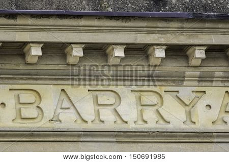 The name Barry isolated from a larger latin inscription carved in stone
