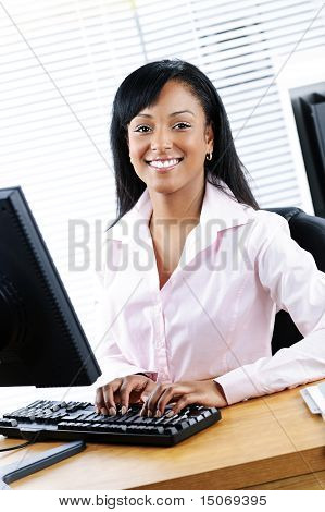 Happy Black Businesswoman At Desk
