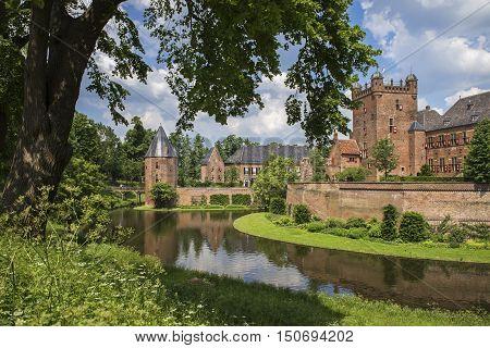 S'HEERENBERG, GELDERLAND/ THE NETHERLANDS - JUNI 4,2016:View of the historical castle Haus Berg in summer