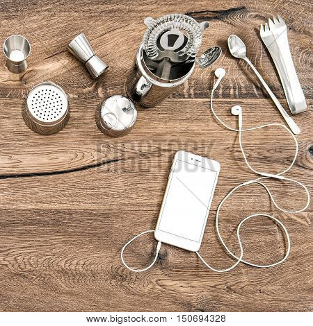Bar counter with tools accessories and electronic devices. Food drink background