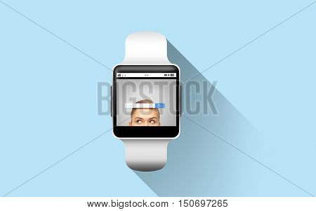modern technology, object and media concept - close up of black smart watch with internet browser search bar on screen over blue background