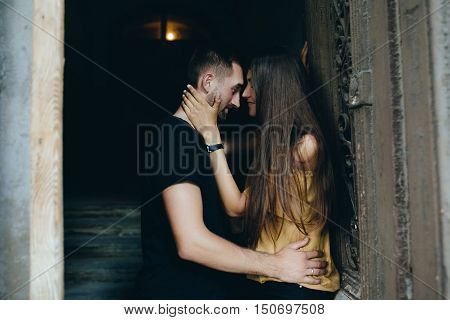 couple posing in the doorway posing on camera