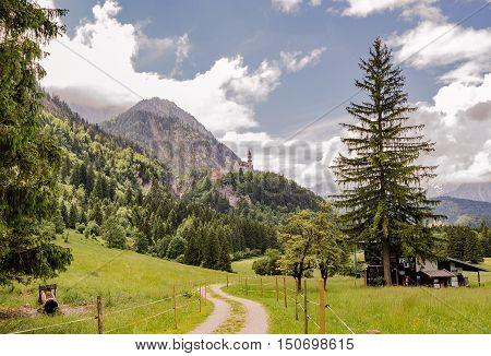 SCHWANGAU GERMANY - JUNE 6 2016: Amazing landscape of Bavaria with views of Neuschwanstein castle Germany