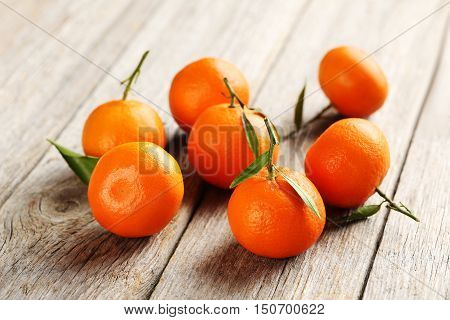 Ripe Mandarin On A Grey Wooden Table