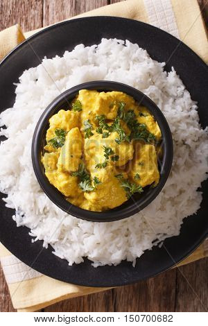 Chicken Korma On A Mildly Spiced Creamy Sauce Close-up. Vertical Top View