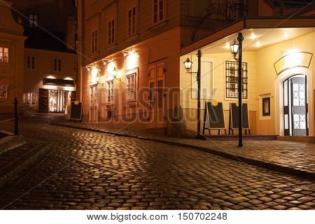 Illuminated cobbled street by late  evening, Vienna, Austria.