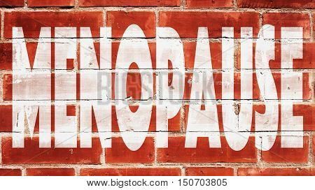 Menopause Written On A Red Brick Wall