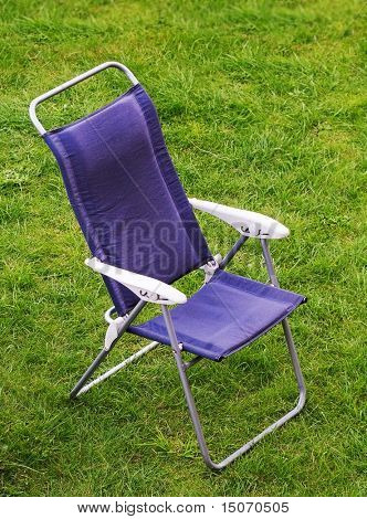 Canvas chair on a green grass