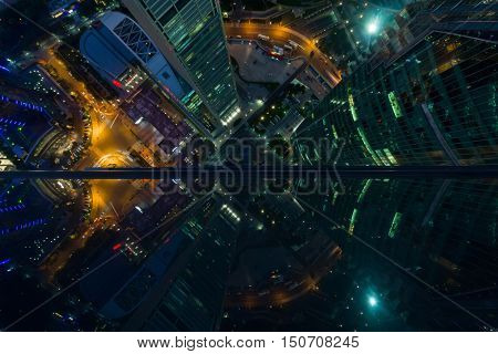 Skyscrapers with illumination in Shanghai city at night, top view from One Lujiazui building