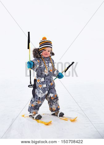 Small child toddler 25 years first time up on skis