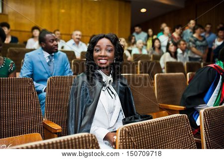 Happy Beautiful Black African American Girl With Hat And Gown Graduates At Ceremony Graduated