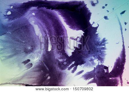 Dark spreads ink stains on a white background