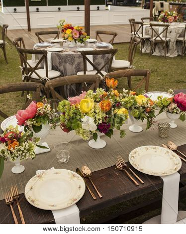 arrangement of tables with antique plates for reception