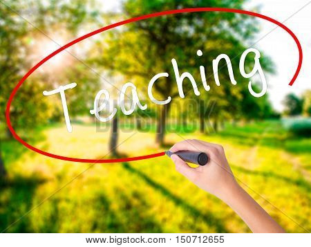 Woman Hand Writing Teaching With A Marker Over Transparent Board