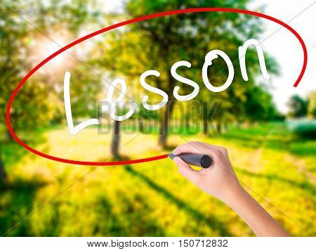 Woman Hand Writing Lesson With A Marker Over Transparent Board